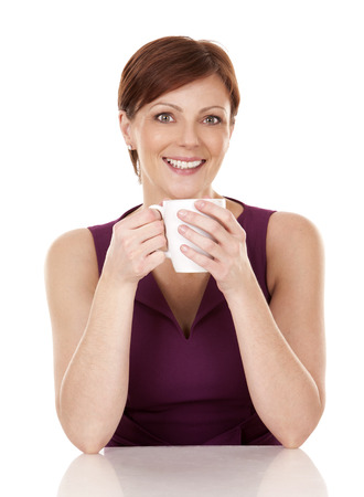 upscale: caucasian woman in her 30s drinking cup of coffee on white