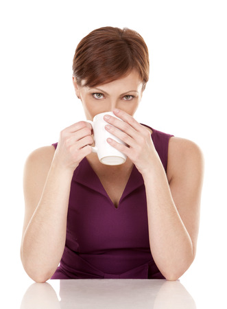 thirties portrait: caucasian woman in her 30s drinking cup of coffee on white