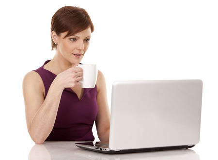 business woman working with her laptop sitting down on white background