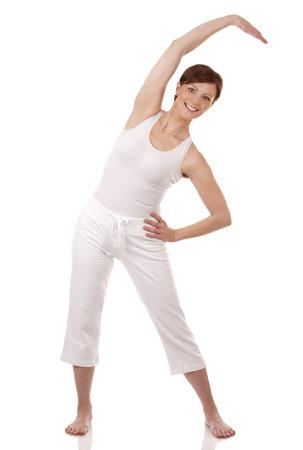 pretty brunette in white active wear on white background