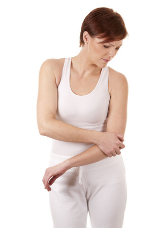 female elbow: woman witha elbow pain wearing white outfit on white background