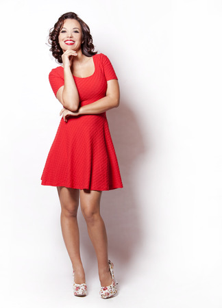 beautiful woman wearing red summer dress on white background photo