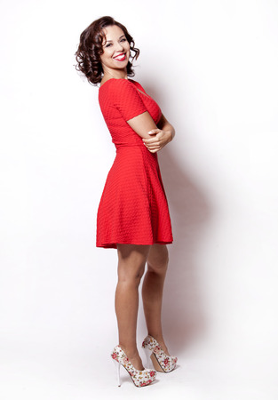 beautiful woman wearing red summer dress on white background