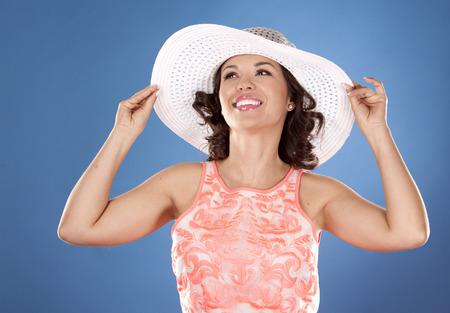 beautiful woman wearing pink summer dress on blue background