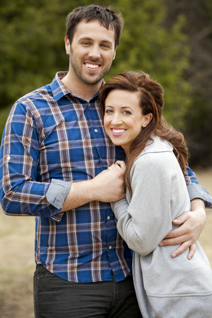 young couple wearing casual outfits in the park photo