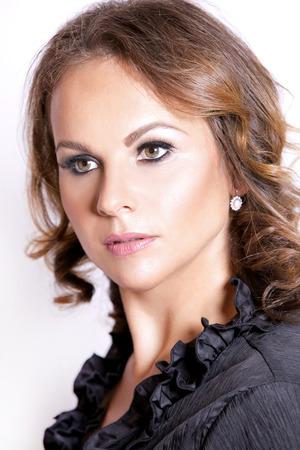 upscale: beautiful woman wearing black upscale outfit on white background Stock Photo