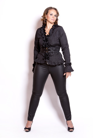 size: beautiful woman wearing black upscale outfit on white background Stock Photo