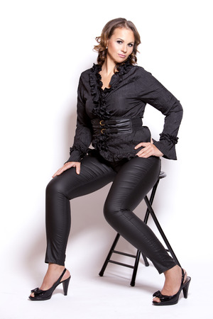 plus size woman: beautiful woman wearing black upscale outfit on white background Stock Photo