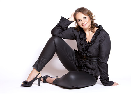 plus size woman: beautiful woman wearing black upscale outfit on white background Stock Photo