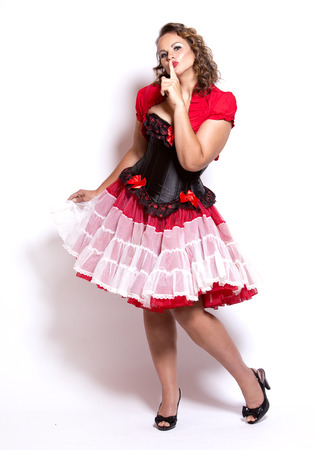 beautiful woman wearing red and black pinup outfit
