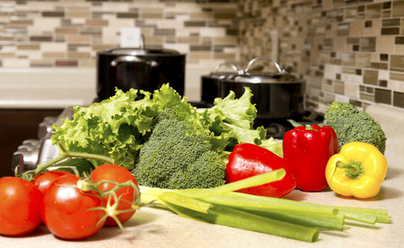 raw vegetables on the table in the kitchen closeup