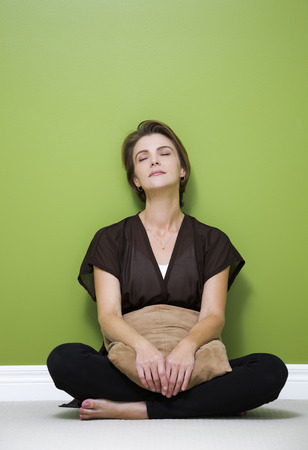 caucasian woman sitting down and relaxing in the green room