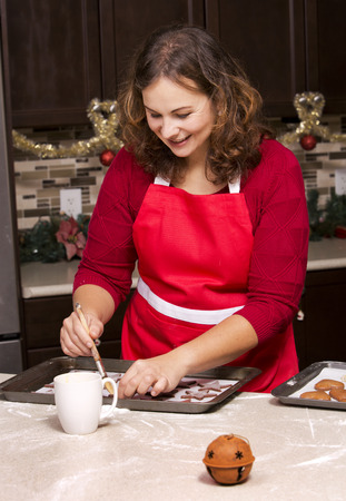 woman making ginger bread cookies in the kitchen photo
