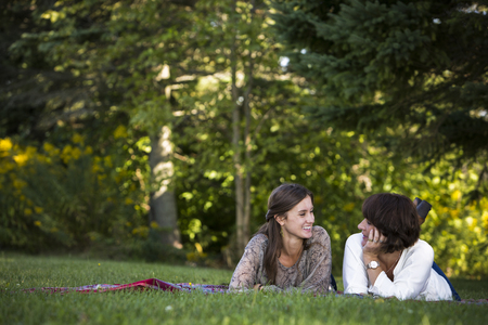 daughter: caucasian mother and daughter together in the park