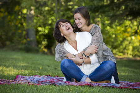caucasian mother and daughter together in the park Stock Photo - 46944144