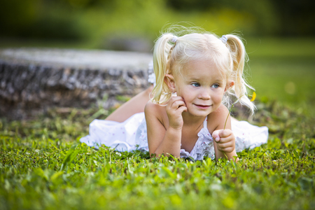charming girl: caucasian girl smiling and playing in the park