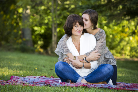 mum and daughter: caucasian mother and daughter together in the park