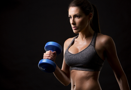 WOMAN FITNESS: pretty caucasian fitness woman on black isolated background