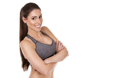 pretty caucasian fitness woman on white isolated background