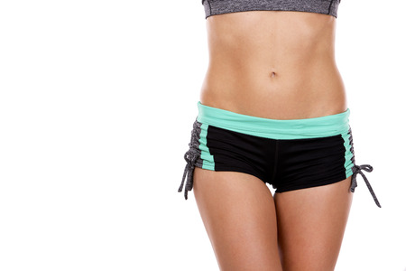 6 pack: beautiful abdomen of young caucasian athlete on white background