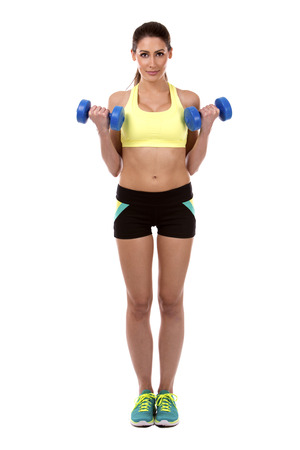 shrugs: pretty caucasian fitness woman on white isolated background