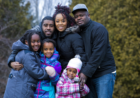 boy lady: casual winter young black family outdoors in the park