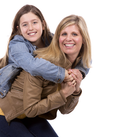 mama e hija: caucasian mother and daughter on white studio background