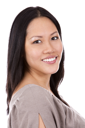 female beauty: pretty casual asian woman on white isolated background