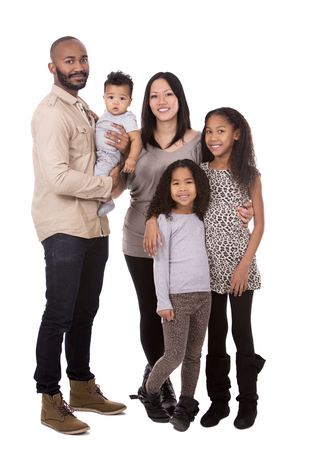 family isolated: casual young mixed family on white isolated background