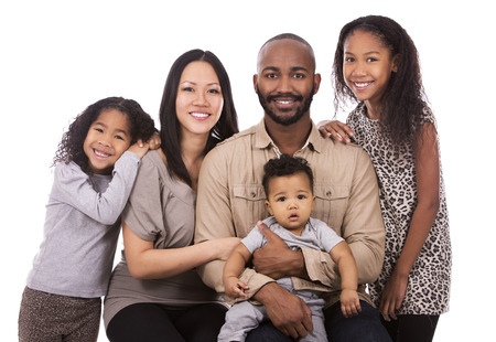 carrying girl: casual young mixed family on white isolated background