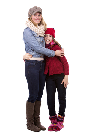 adult offspring: caucasian mother and daughter on white studio background