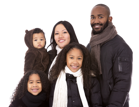 casual winter mixed family on white isolated background