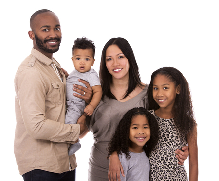 chinese american: casual young mixed family on white isolated background