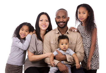 mixed family: casual young mixed family on white isolated background