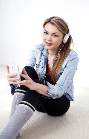 girl sit: pretty caucasian casual woman using cellphone