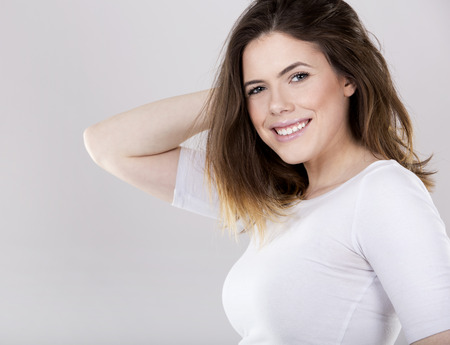 young casual beautiful brunette on white studio background Stock Photo