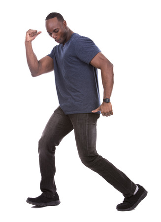 success man: young excited casual black man dancing on white background Stock Photo