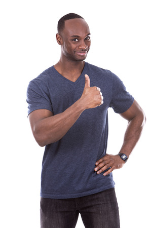 smiling man: young excited casual black man giving thumbs up on white background
