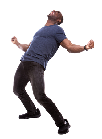 young excited casual black man screaming on white background Archivio Fotografico