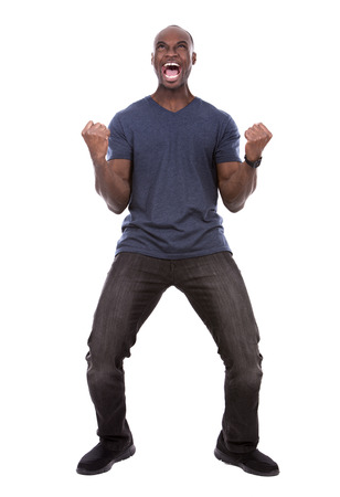 screaming: young excited casual black man screaming on white background Stock Photo