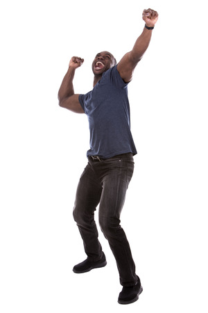 young excited casual black man screaming on white background Foto de archivo