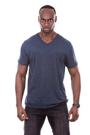 pissed: young casual black man wearing blue tshirt on white background