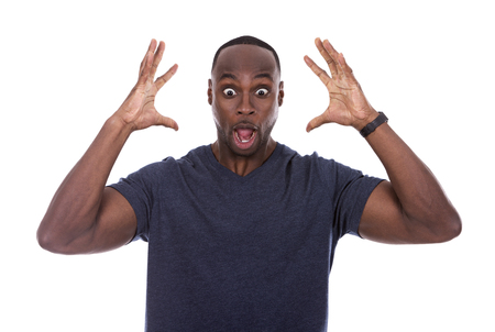 african american man: young excited casual black man shocked on white background