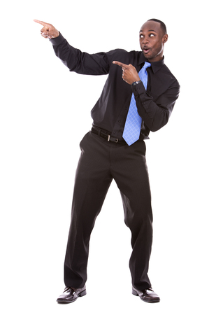 young excited casual black man  pointing hand on white background Stock Photo