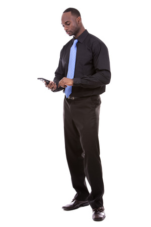 jamaican man: young black business man using cellphone on white background Stock Photo