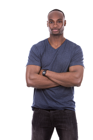funny guys: young casual black man wearing blue tshirt on white background
