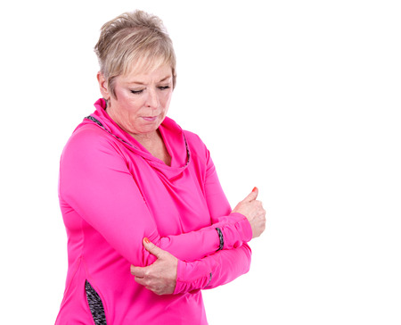 female elbow: caucasian middle aged woman is suffering pain in her elbows
