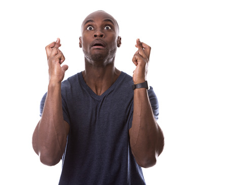 freaked out: young hopefull casual black man on white background