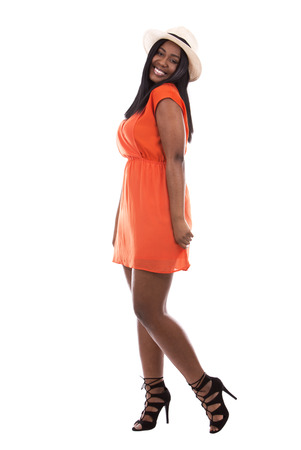 negras africanas: young black woman wearing bright dress on white background Foto de archivo