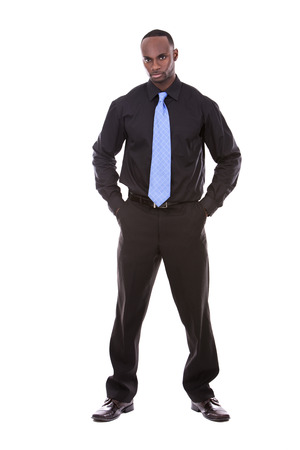 jamaican adult: young black business man posing on white background